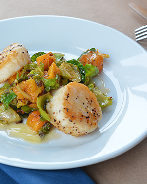 Pan-Seared Scallops with Smoked Butternut Squash and Brussels Sprouts are now on the menu at Cowfish!